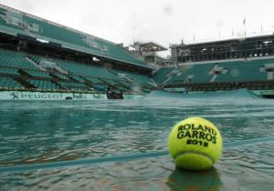 -ball-is-seen-in-a-puddle-on-the-philippe-chartrier-court-as-rain-stops-play-during-the-french-open-tennis-tournament-at-the-roland-garros-stadium-in-paris