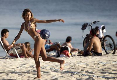 2387566_a-girl-controls-a-soccer-ball-in-ipanema-beach-in-rio-de-janeiro